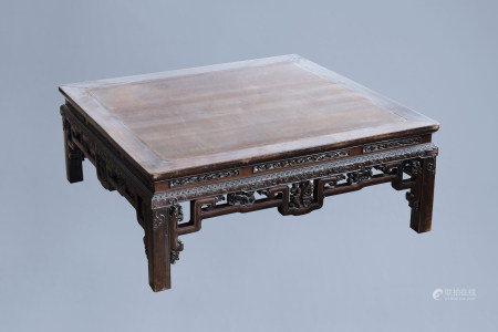An rectangular Chinese carved wooden coffee table with glass top, 19th/20th C.