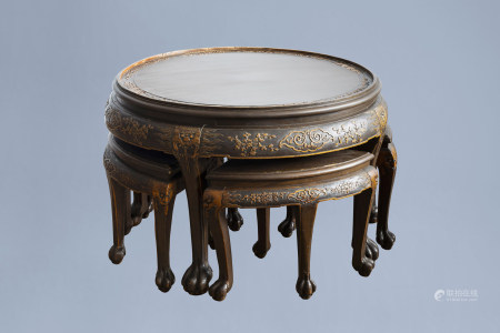 A Chinese wooden coffee table and four stools with relief design, 20th C.