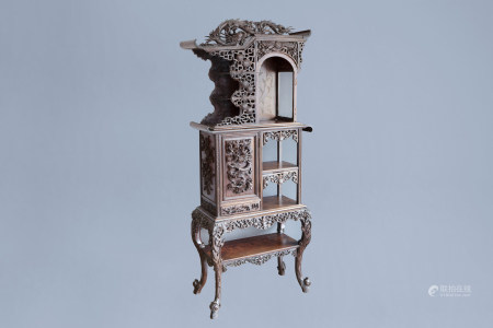 A Chinese reticulated wooden 'dragons' display cabinet, ca. 1900