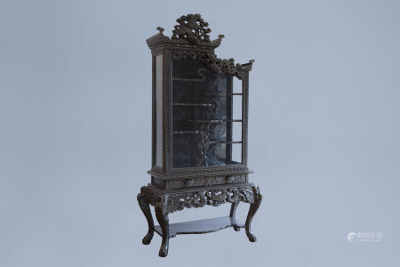 A Chinese or Japanese reticulated wooden 'dragons' display cabinet, ca. 1900