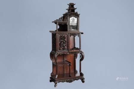 A Chinese reticulated wooden 'dragon' display cabinet, ca. 1900