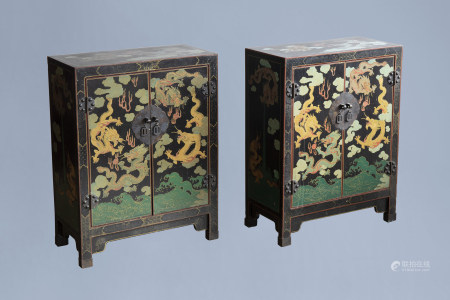A pair of Chinese black lacquered wooden 'dragons chasing the pearl' two-door cabinets, 20th C.