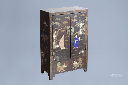 A Chinese lacquered and inlaid wooden two-door cabinet with figures in a landscape and floral design, 19th/20th C.