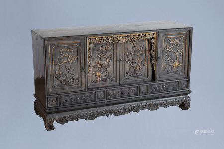 A Chinese lacquered, partly gilt and carved wooden 'four seasons' sideboard, 19th/20th C.