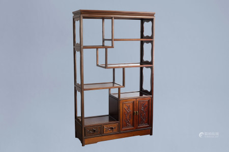 A Chinese wooden display cabinet with floral design, 20th C.