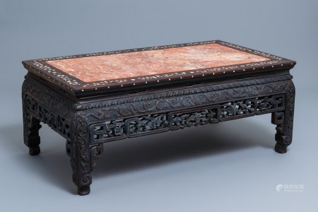 A Chinese mother-of-pearl inlaid wooden low side table with marble top, 19th C.