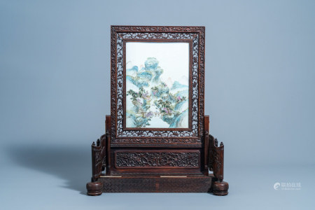 A Chinese qianjiang cai plaque with an animated landscape mounted in a wooden bone inlaid table screen, Republic, 20th C.