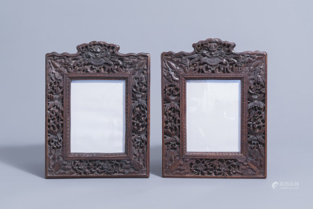 A pair of Chinese carved wooden frames with animals and flowers, 19th C.