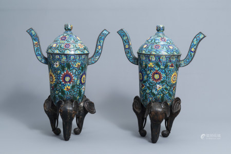 A pair of large Chinese cloisonne tripod censers and covers with floral design, 19th C.
