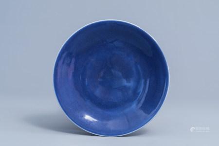 A Chinese monochrome 'sacrificial blue' plate, Qianlong