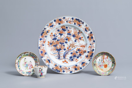 A Chinese Imari style charger with floral design and two famille rose saucers and a cup, 18th/19th C.