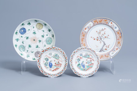 Four various Chinese famille verte and Imari style plates with floral design and a figure in a landscape, Kangxi