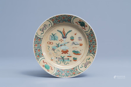 A Chinese famille verte light brown ground 'antiquities' plate, Kangxi