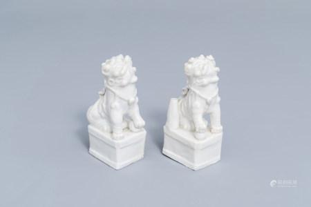 A pair of Chinese blanc de Chine joss-stick holders modelled as Buddhist lions, Kangxi