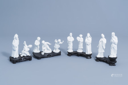 Ten various Chinese blanc de Chine figures on a wooden base, 20th C.