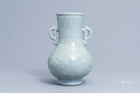 A Japanese celadon glazed 'lotus scroll' bottle vase, Edo/Meiji, 18th/19th C.