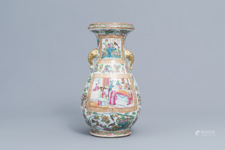 A Chinese Canton famille rose bottle vase with elephant head shaped handles, 19th C.