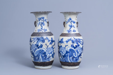 A pair of Chinese blue and white Nanking crackle glazed vases with birds among blossoming branches, 19th C.