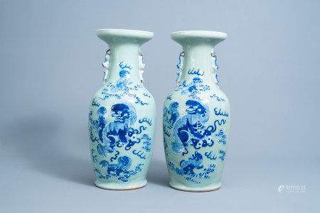 A pair of Chinese blue and white celadon vases with Buddhist lions, 19th C.