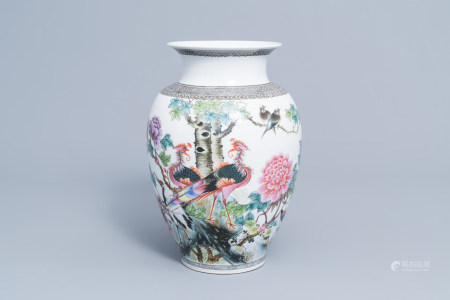 A Chinese famille rose vase with various birds among blossoming branches, Qianlong mark, Republic, 20th C.