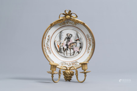 A Chinese famille rose 'Don Quichote' plate mounted as a two-branch wall light, 19th/20th C.