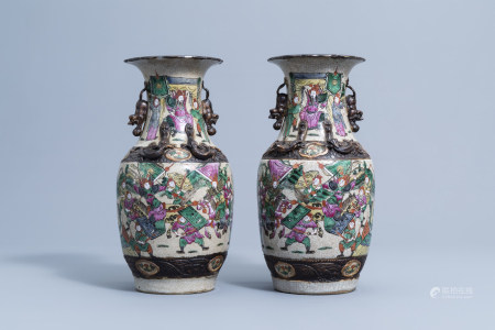 A pair of Chinese Nanking crackle glazed famille rose vases with warrior scenes, 19th C.