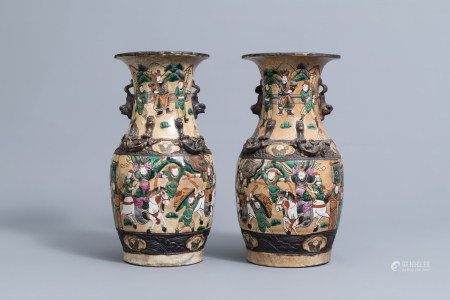 A pair of Chinese Nanking crackle glazed famille rose 'warrior' vases, 19th C.