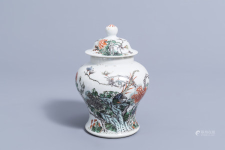 A Chinese famille verte vase and cover with a pheasant among flowers, 19th C.