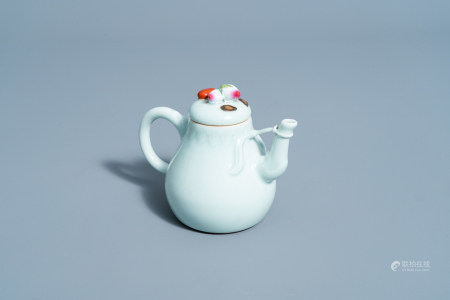 A Chinese famille rose celadon ground teapot and cover, Qianlong mark, 19th/20th C.