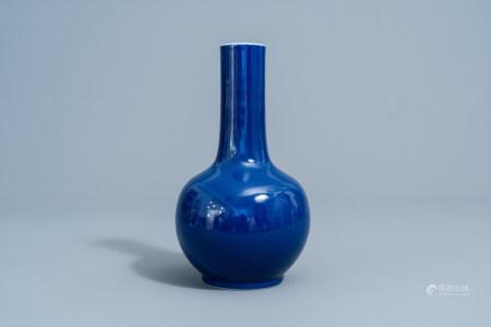 A Chinese monochrome blue bottle vase, 20th C.