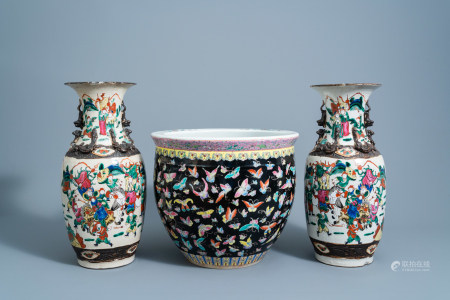 A pair of Chinese Nanking crackle glazed famille rose vases with warrior scenes and a black ground famille rose 'butterflies' jardiniere, 19th/20th C.