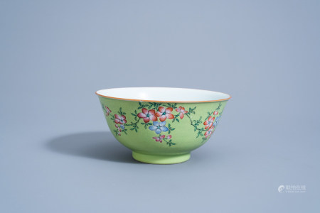 A Chinese famille rose lime green ground bowl with floral design, Qianlong mark, 19th C.