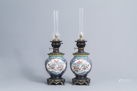 A pair of Chinese famille rose 'warrior' vases mounted as oil lamps, 19th C