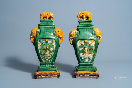 A pair of Chinese sancai glazedv ases and covers with sea dragons and elephants, 19th/20th C.