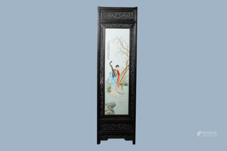 A framed Chinese Qianjiang cai plaque with a lady making music in a landscape, 20th C.