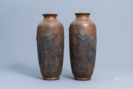 A pair of Chinese stoneware vases with a peacock on a rock among blossoming branches, seal mark, ca. 1900