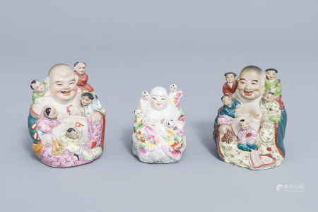Three Chinese famille rose figures of Buddha with children, 20th C.