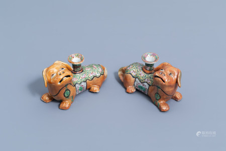 A pair of Chinese Canton famille rose dog shaped candlesticks, 19th C.