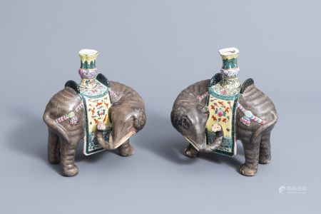 A pair of Chinese famille rose models of elephants carrying vases, 20th C.