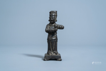 A Chinese bronze figure of a guardian, Ming