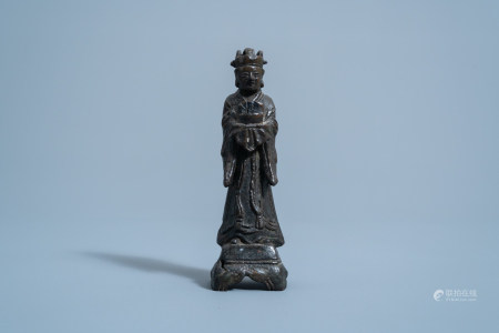 A Chinese bronze figure of a standing official, Ming