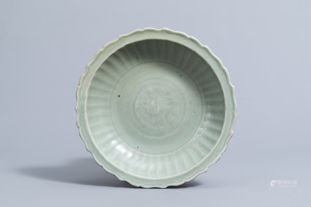 A Chinese lotus shaped Longquan celadon charger with underglaze floral design, Ming