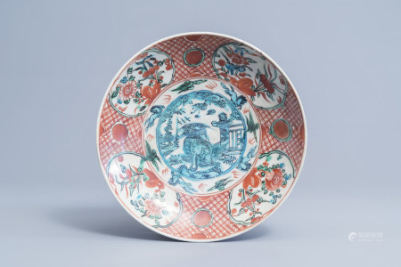 A Chinese polychrome Swatow dish with a Buddhist lion, Ming