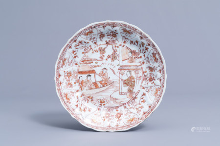 A Chinese milk and blood plate with figures in a landscape, Kangxi