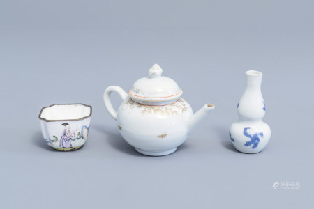 A Chinese gilt miniature teapot, a Canton enamel cup and a blue and white doll's house miniature vase with boys, Kangxi/Qianlong