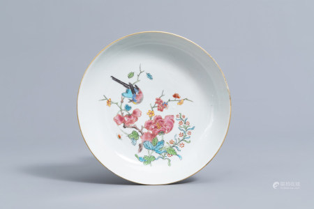 A Chinese famille rose dish with a bird among blossoming branches, Yongzheng