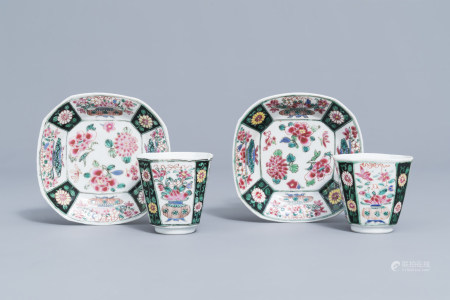 A pair of Chinese famille rose black ground cups and saucers with floral design, Yongzheng/Qianlong