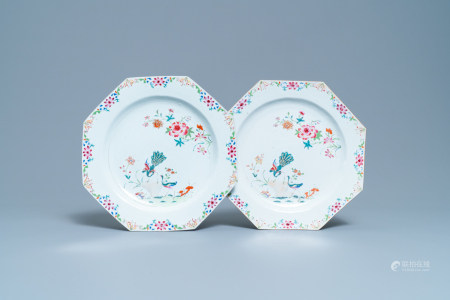 A pair of Chinese octagonal famille rose 'peacock' chargers, Qianlong