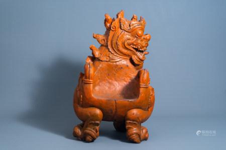 A Tibetan carved wooden 'dragon' chair, 19th/20th C.