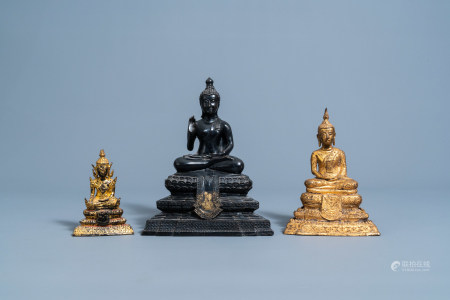 Three gilt and patinated bronze figures of Buddha, Southeast Asia, 19th/20th C.